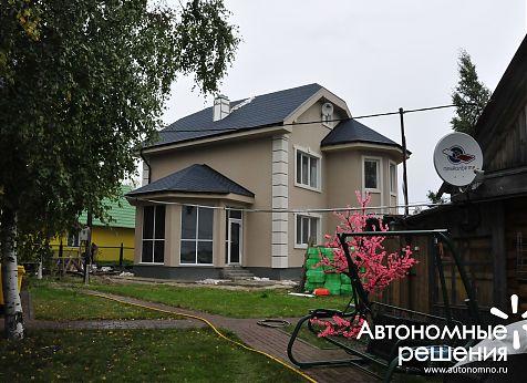 Система отопления на пеллетах Froling P4 Pellet 60 кВт отапливает дом, баню и гараж в Сургуте на берегу озера